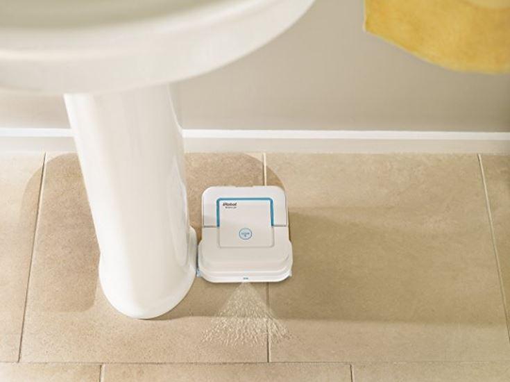 The iRobot Braava mop cleans a bathroom floor