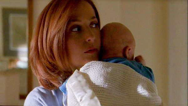 Scully holds a baby on the X-files