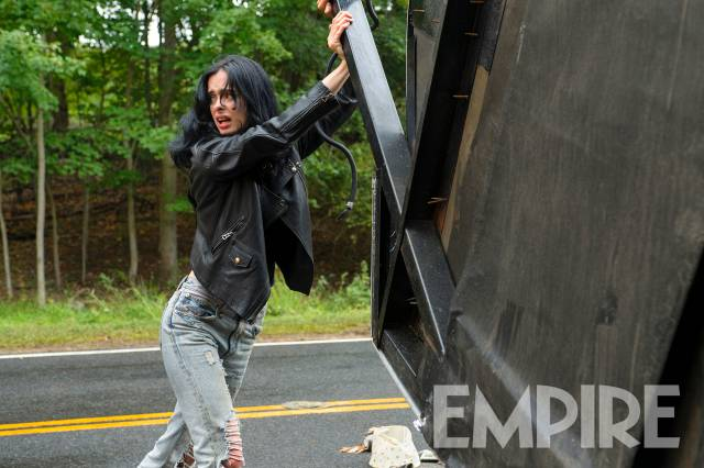 Jessica Jones lifting up a car
