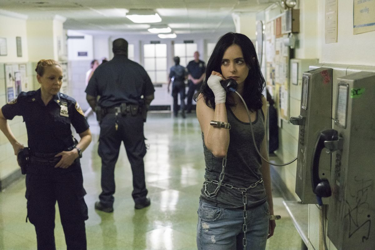 Jessica making a call at a police station in Jessica Jones Season 2