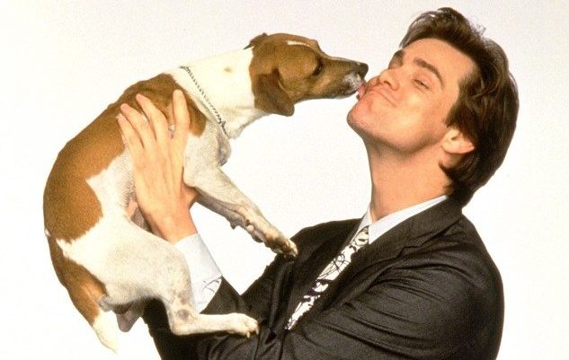 Jim Carrey holding the dog from his movie, The Mask