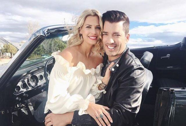Jonathan Scott and Jacinta Kuznetsov posing in a car