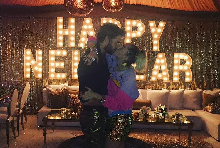 Liam Hemsworth and Miley Cyrus kiss on New Year's Eve