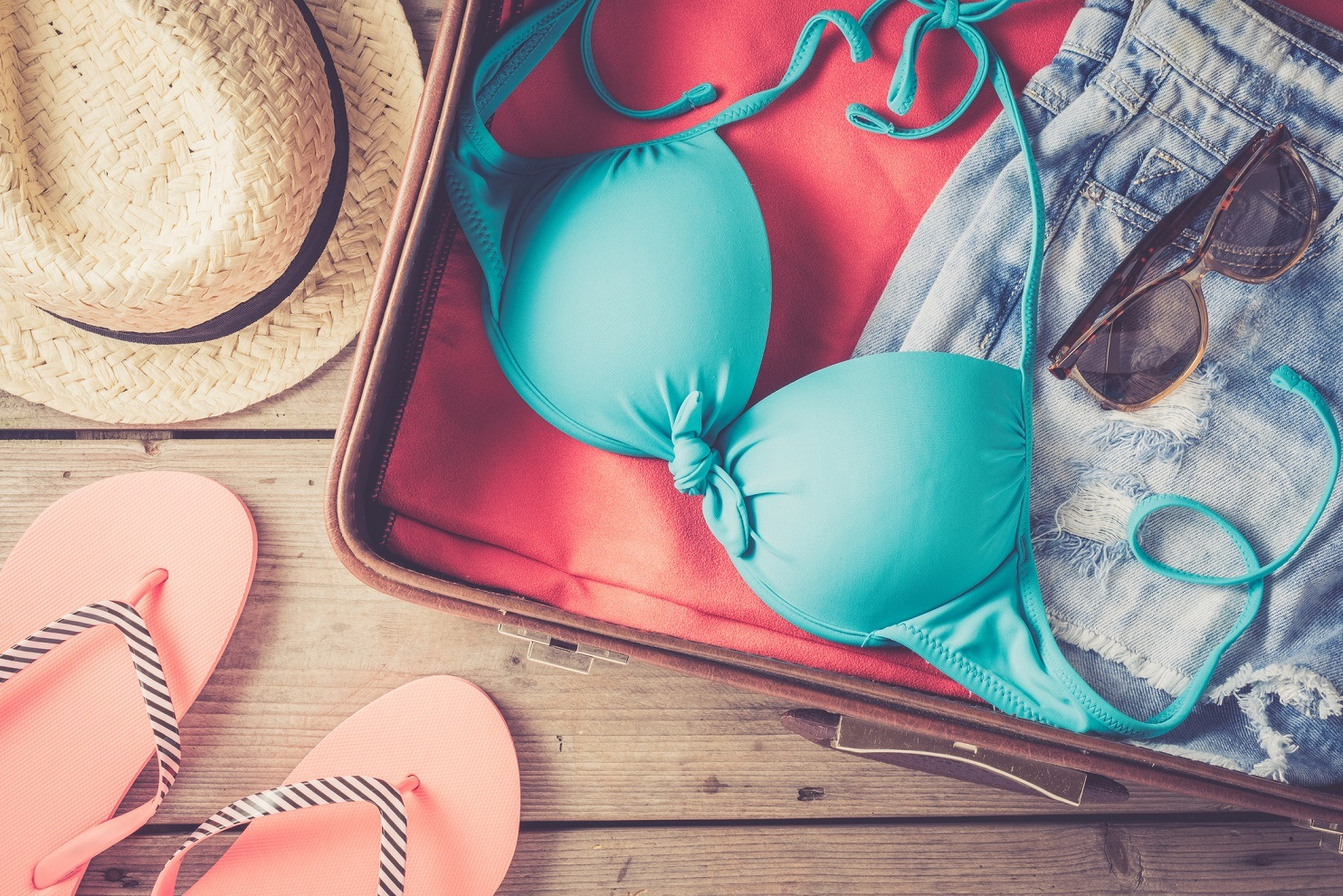 Packing suitcase with swimsuit