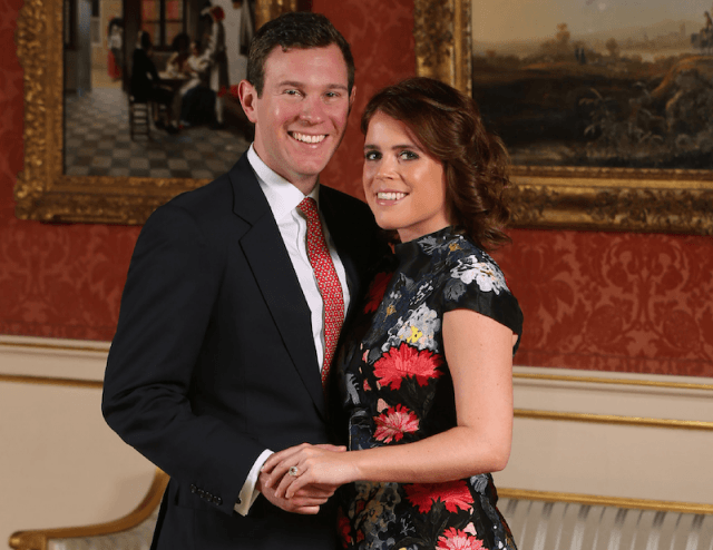 Princess Eugenie and her fiancé pose in front of a painting.