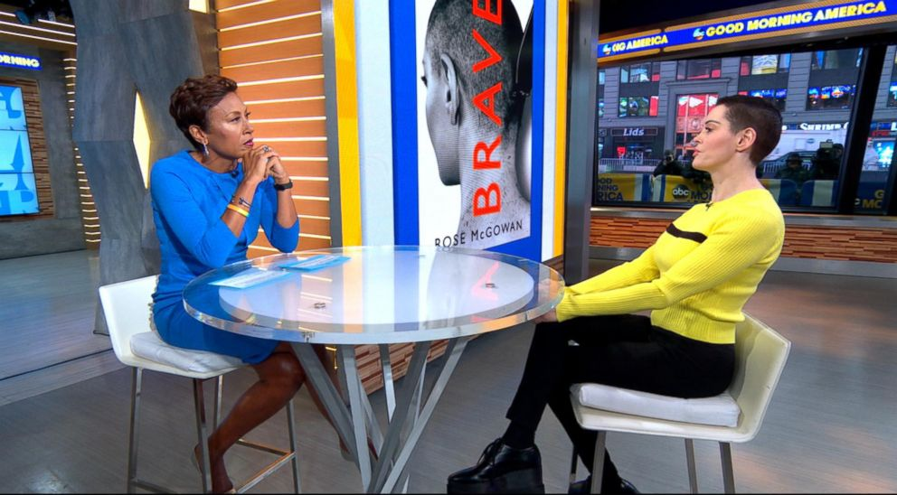 Rose McGowan sits across a table from Robin Roberts