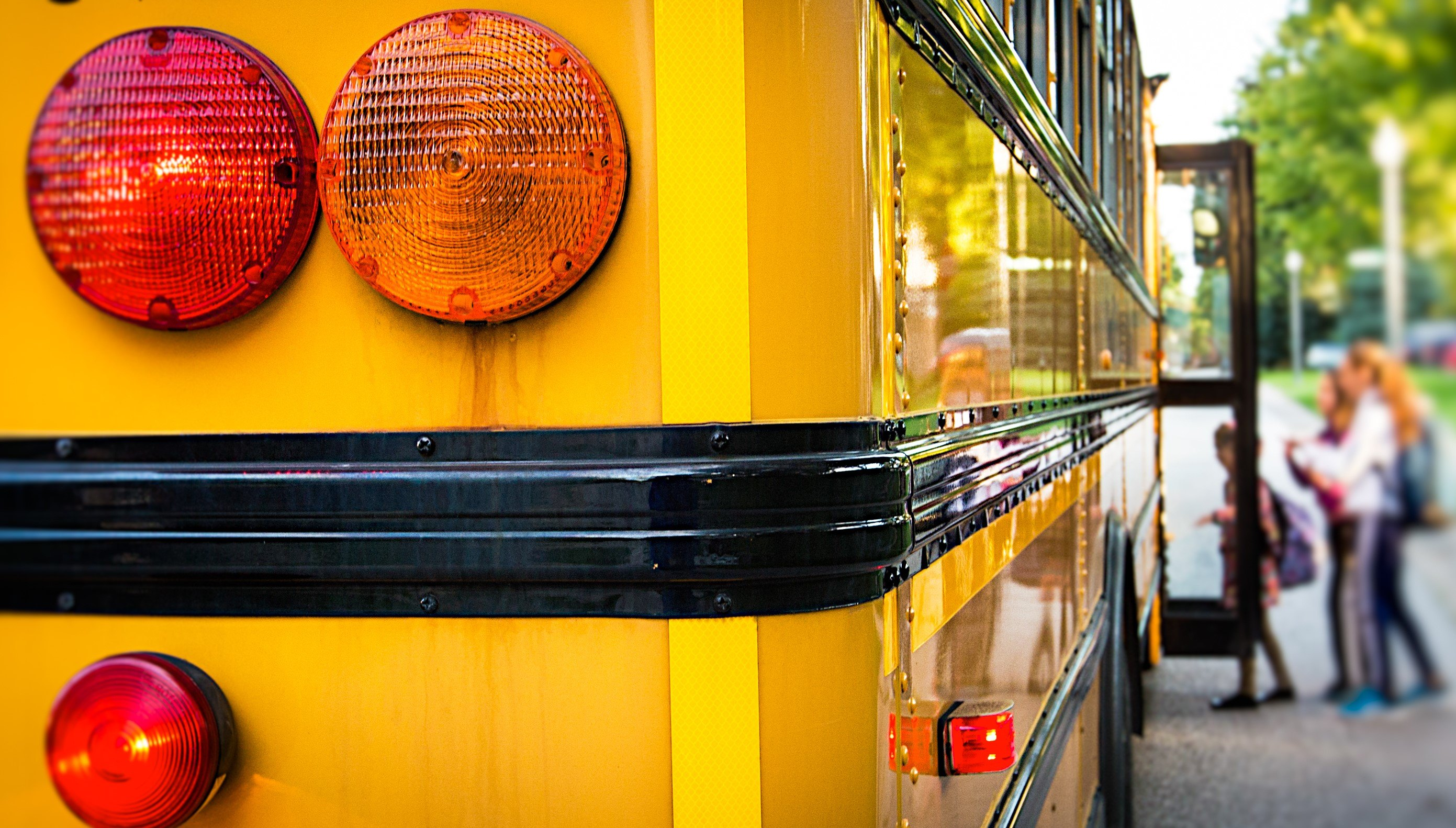 Yellow School Bus from the back as children get in