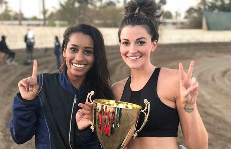 Seinne Fleming and fellow contestant Tia with their demolition derby trophy