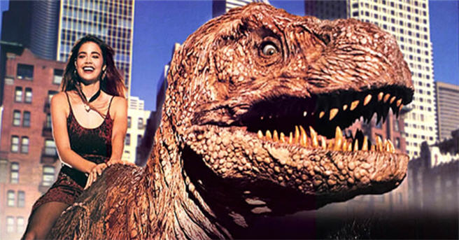 Denise Richards sits on top of a dinosaur