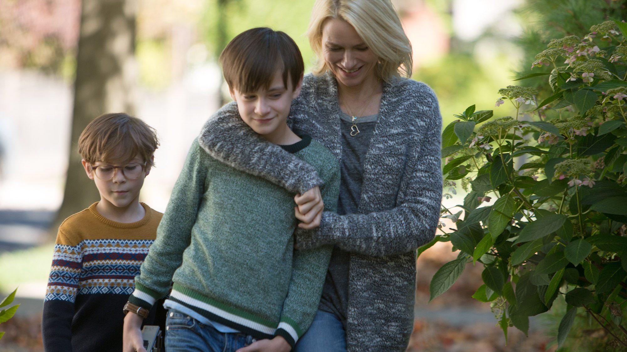 Naomi Watts puts her around a young boy