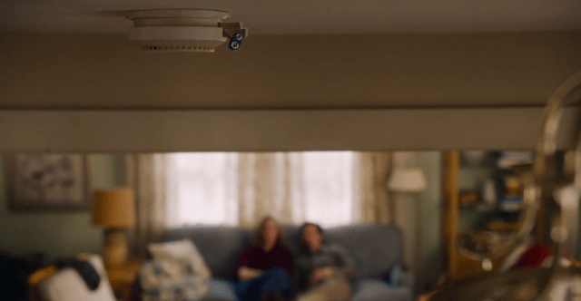 In 'This is Us,' Jack and Rebecca's smoke detector hangs without batteries as they sit and talk on their couch in the background.