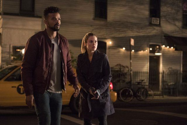 Trish and Malcolm standing in the street together.