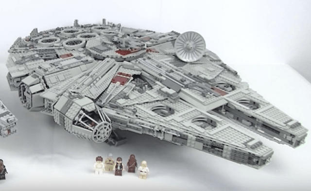 A LEGO Millennium Falcon on a white table.