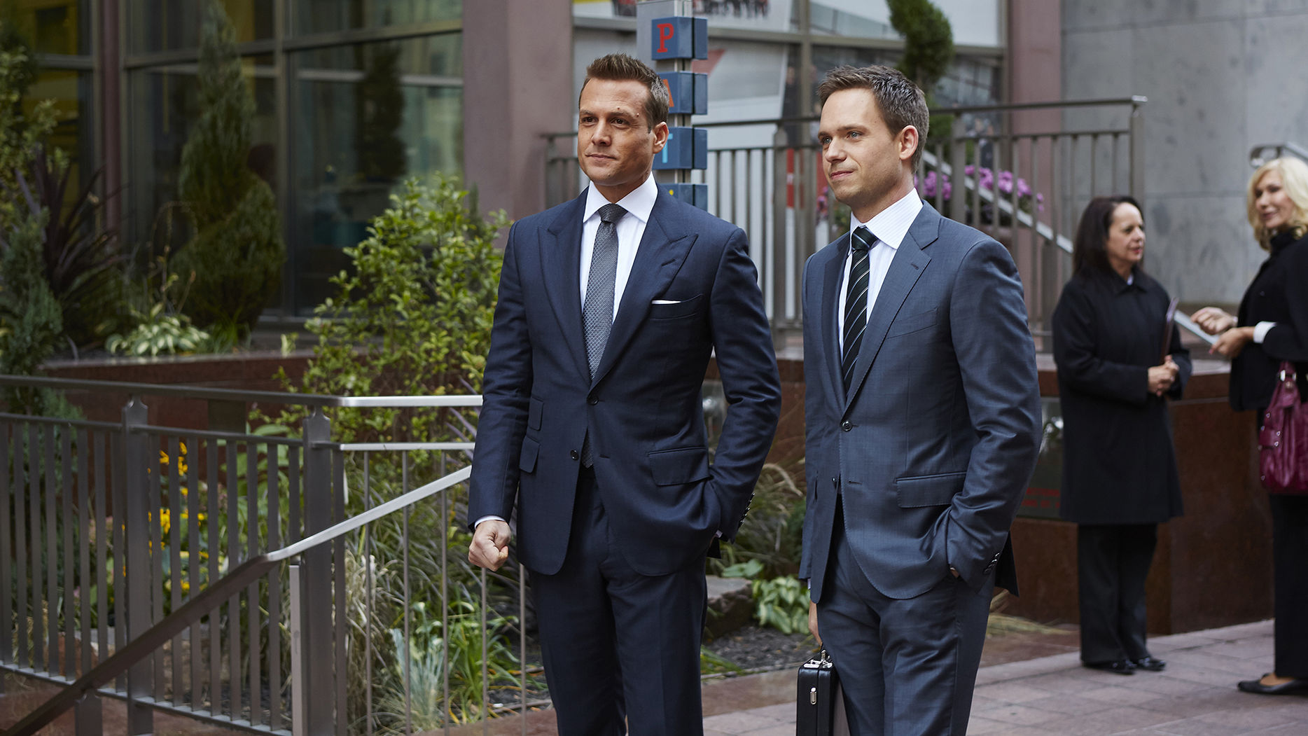 "SUITS -- ""Derailed"" Episode 414 -- Pictured: (l-r) Gabriel Macht as Harvey Specter, Patrick J. Adams as Michael Ross -- (Photo by: Shane Mahood/USA Network)"