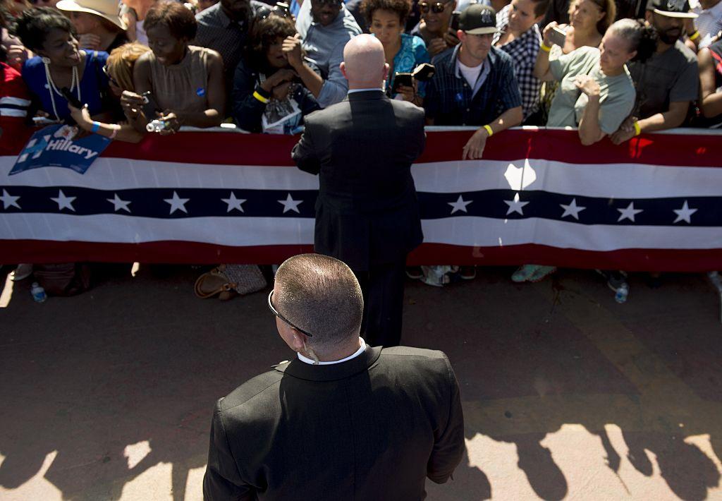 A Secret Service Agent stands watch as US President Barack Obama