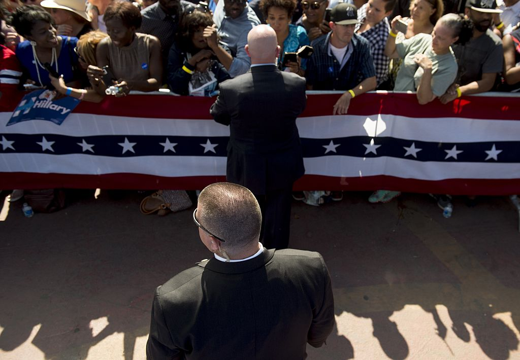 A Secret Service Agent stands watch as US President Barack Obama