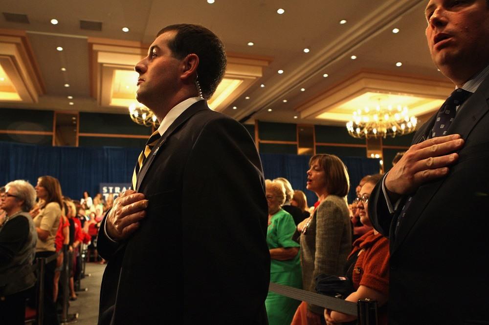 A Secret Service agent recites the Pledge of Allegiance