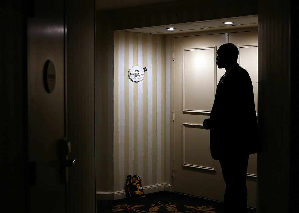 A U.S. Secret Service agent stands guard in front of the hotel room