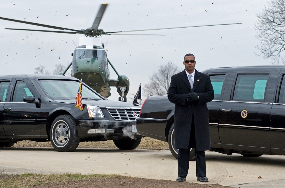 A US Secret Service agent stands by the president's limo