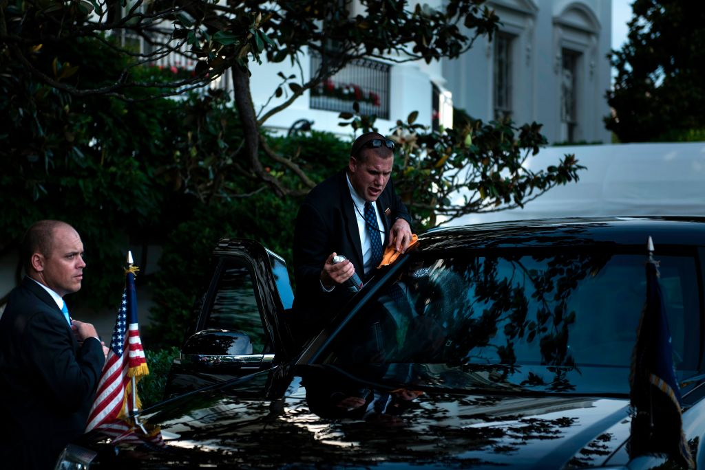 A member of the Secret Service cleans one of US President Donald Trump's armored limousines