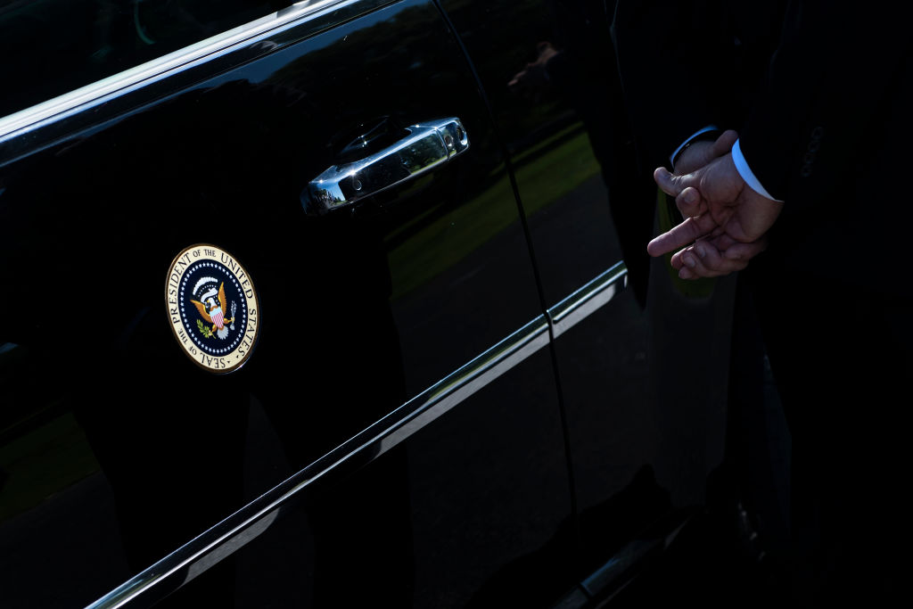 A member of the Secret Service stands with US President Donald Trump