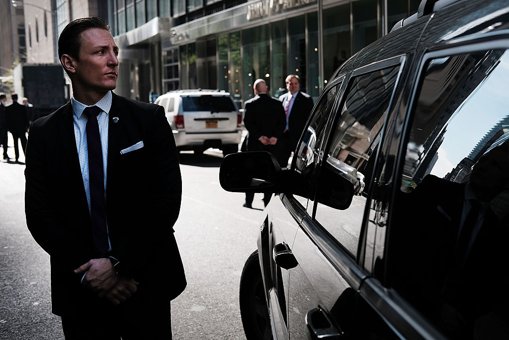 A secret Service agent stands guard outside of Trump Tower