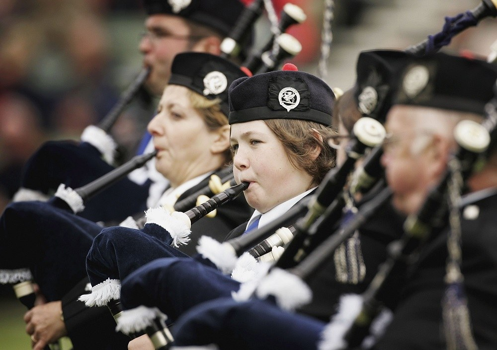 young girl plays the bagpipes