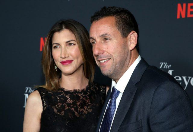 Jackie Sandler and Adam Sandler pose on the red carpet of a screening in Los Angeles.