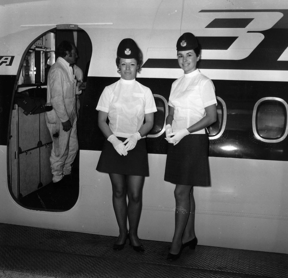 Air hostesses at work just before welcoming boarding passengers