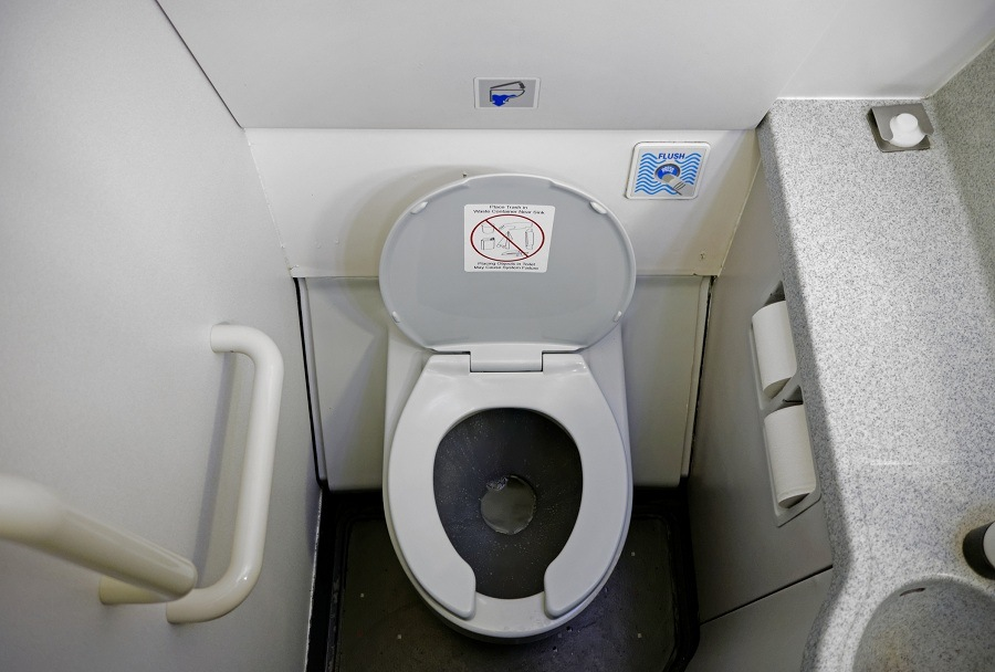 dirty bathroom of a commercial airliner