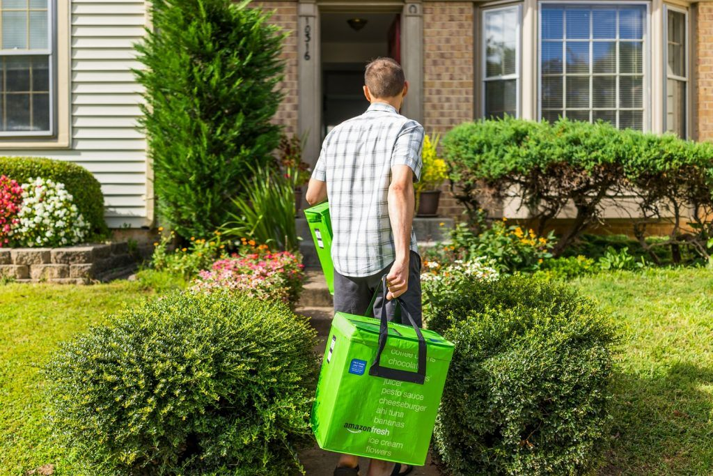 man delivering groceries to a house