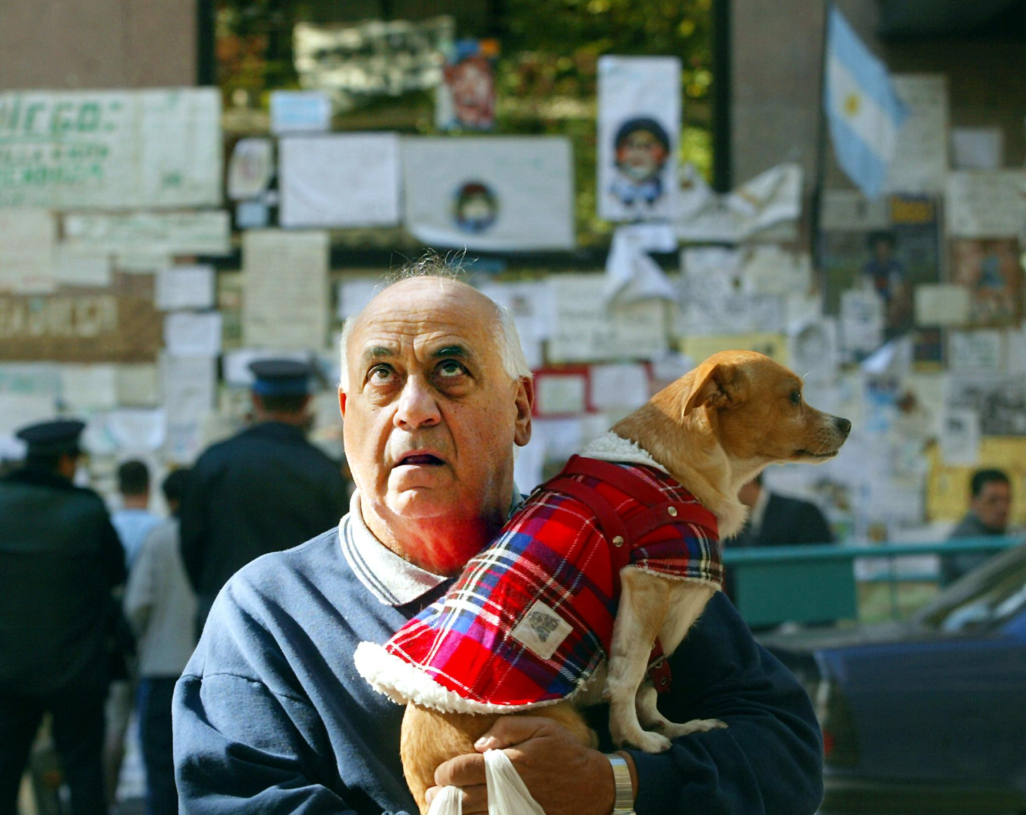 Buenos Aires inhabitant carrying a pet dog