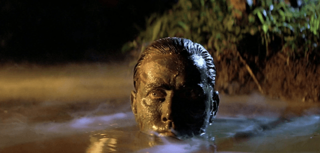 Martin Sheen covered in dirt while inside a pool of water in 'Apocalypse Now'.