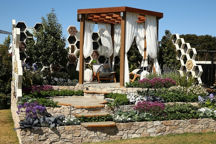A gazebo and garden is seen on display