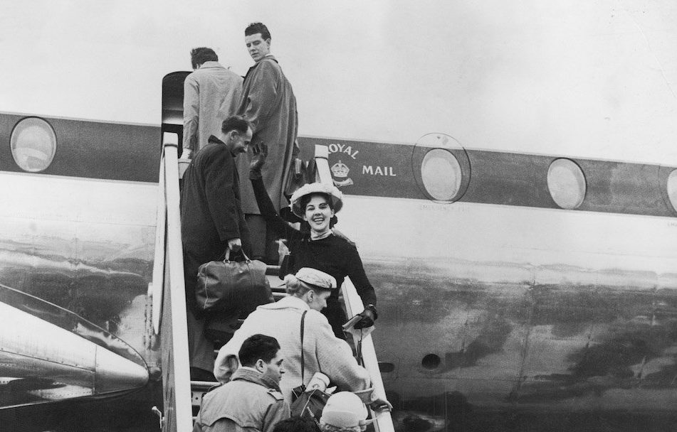 Passengers board BOAC's new Britannia propeller-turbine airliner G-ANBI at London Airport
