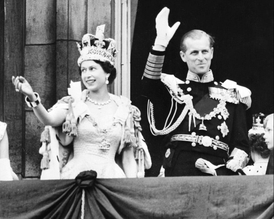 Queen Elizabeth II accompanied by Prince Philip waves to the crowd after being crowned solemnly at Westminter Abbey in London