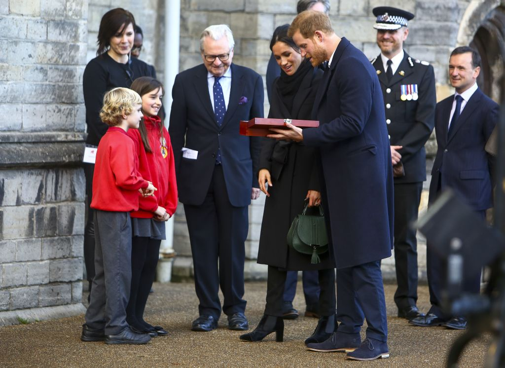 Harry Smith and Megan Taylor, both from Marlborough Primary School, present a wedding gift to Britain's Prince Harry and his fiancée US actress Meghan Markle on their arrival at Cardiff Castle in Cardiff,