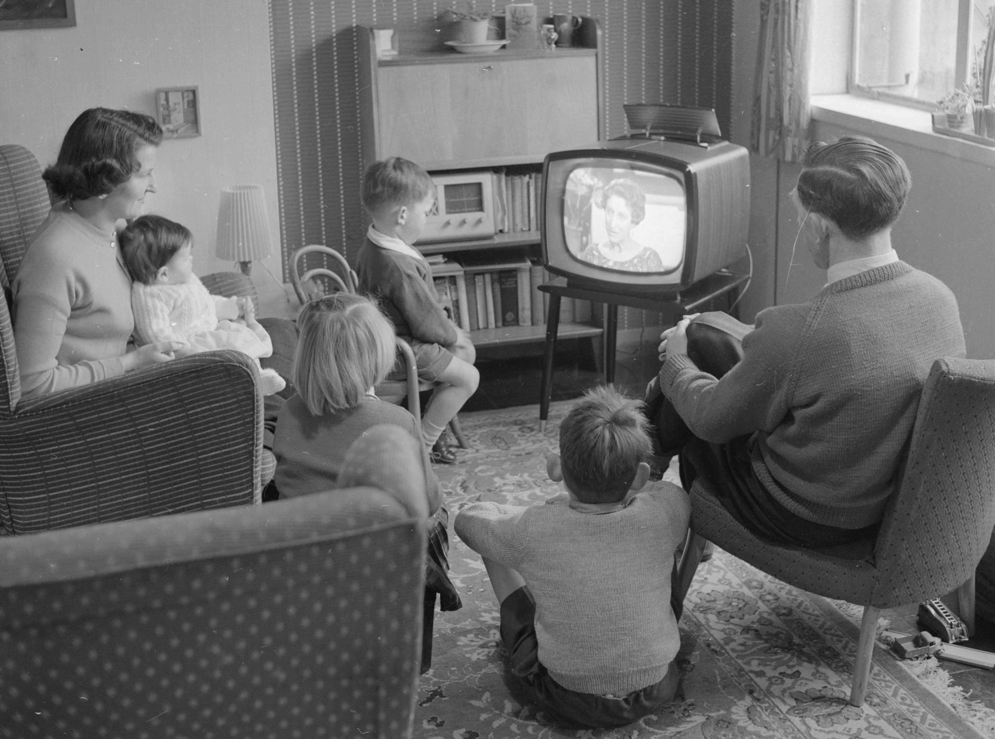 Baby boomers in the 1950s watching TV