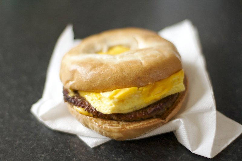 Bagel breakfast sandwich with sausage, egg, and cheese