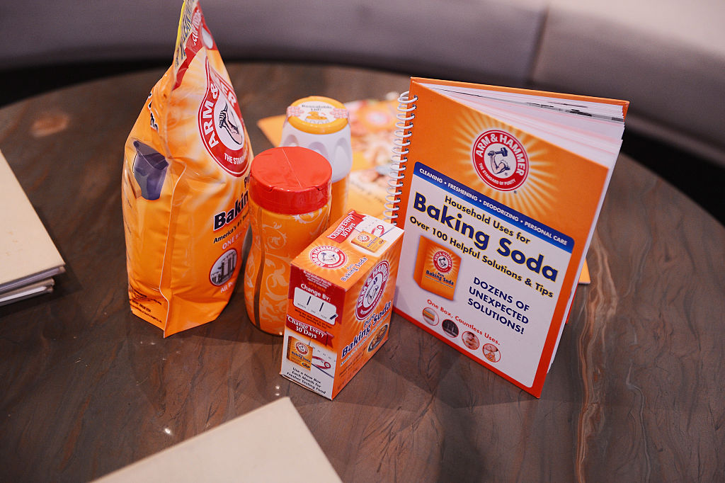 Various baking soda containers on a table.
