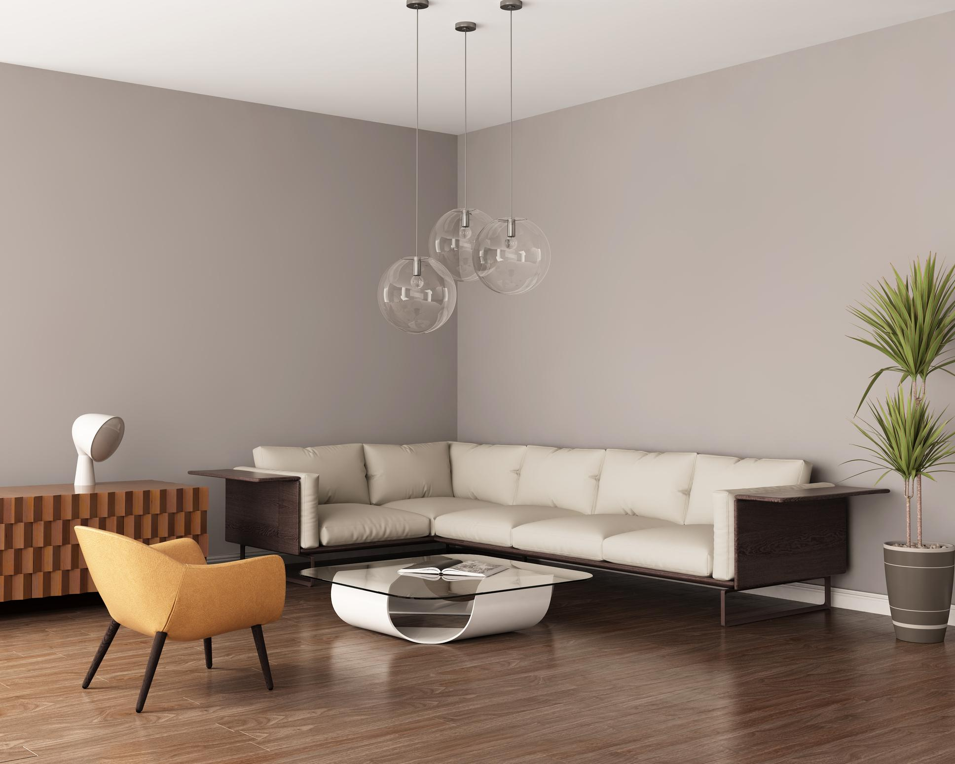 Grey living room with a leather sofa and bamboo flooring