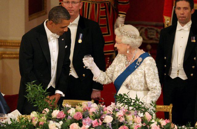 Barack Obama and Queen Elizabeth speaking with each other.