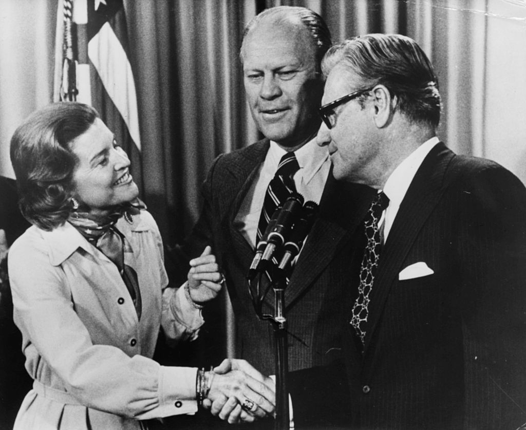 President Gerald Ford and his wife Betty congratulating new Vice President Nelson Rockefeller in a ceremony at the White House