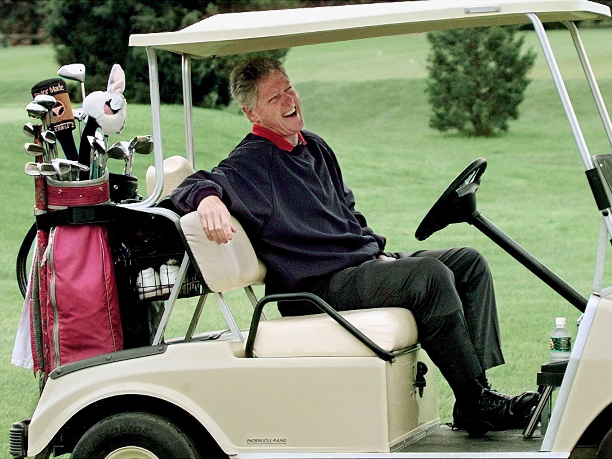 US President Bill Clinton golfing