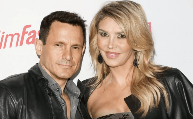 Brandi Glanville and Donald Friese posing together.