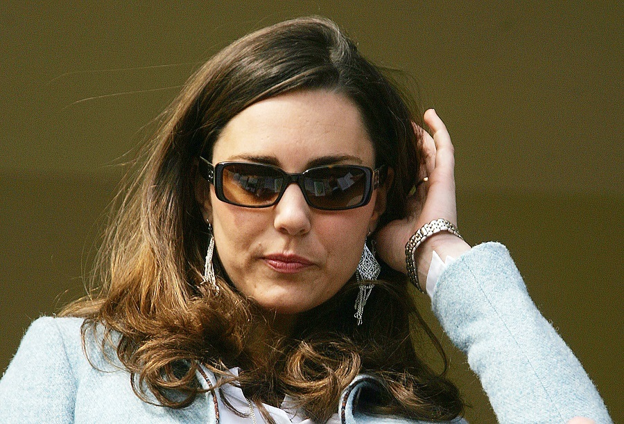 Britain Prince William's girlfriend Kate Middleton stands in the royal box