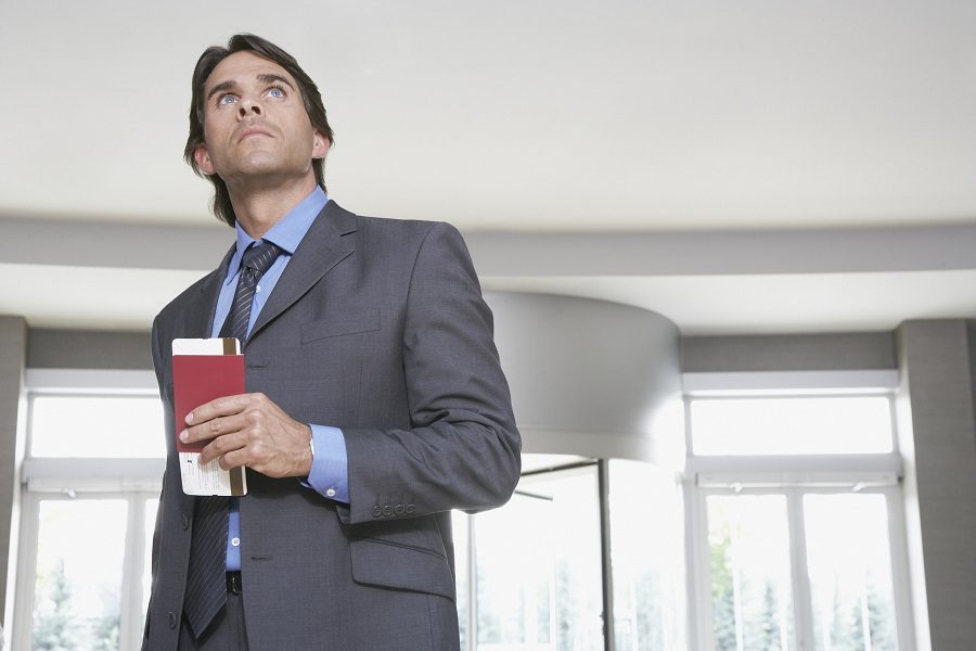 man with passport and airline ticket