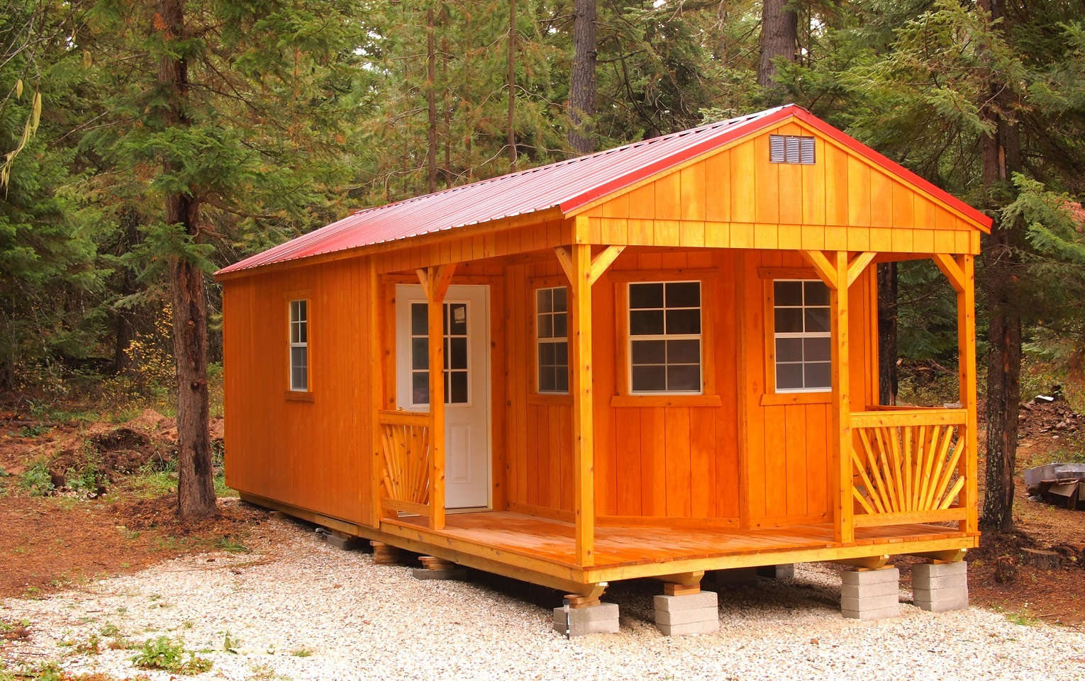 Modern tiny home cabin nestled in woods photo.