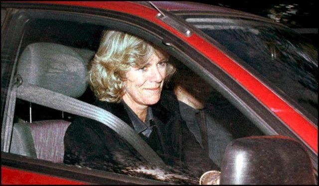 Camilla Parker Bowles inside a red car.
