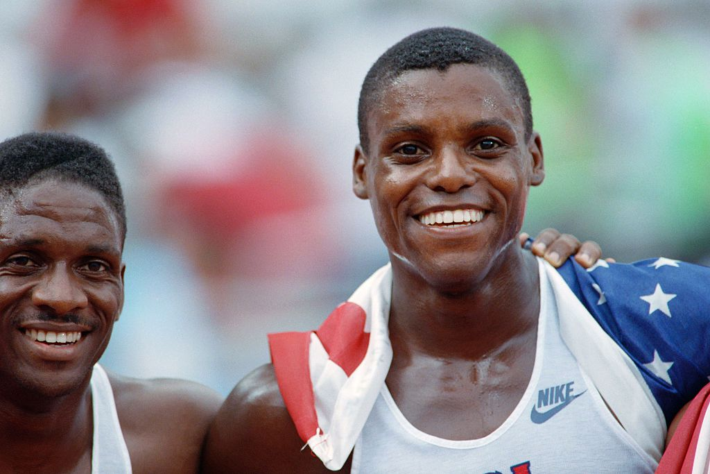 Carl Lewis of the USA smiles after winning
